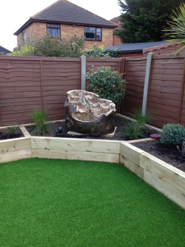 Landscaping decking artificial grass alton landscapes for Garden decking with artificial grass